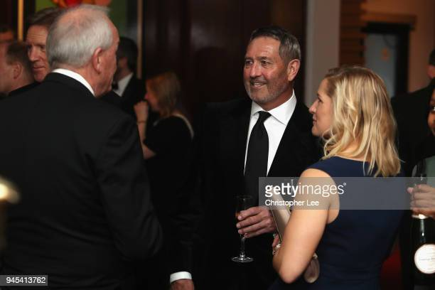 Graham Gooch talks to Katherine Brunt and John Emburey during the PCA Long Room Dinner at Lord's Cricket Ground on April 12, 2018 in London, England.