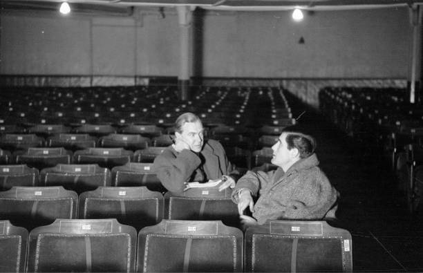 Graham Greene Left And Producer Peter Glenville Watch A Rehearsal Of Greenes First Play