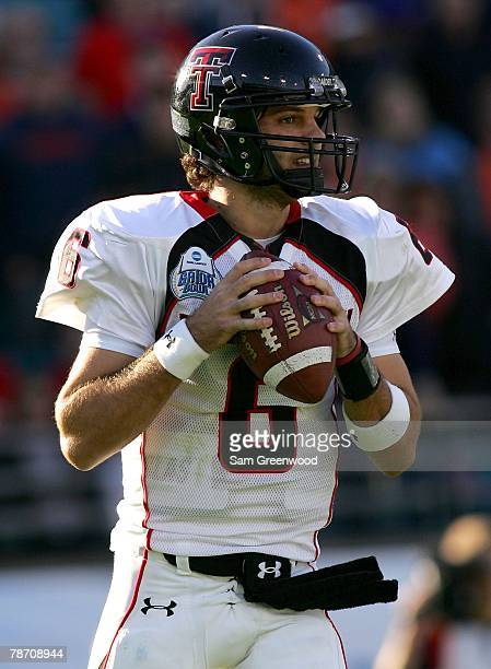 Graham Harrell of the Texas Tech Raiders drops back to pass during the Gator Bowl against the Virginia Cavaliers at Jacksonville Municipal Stadium on...
