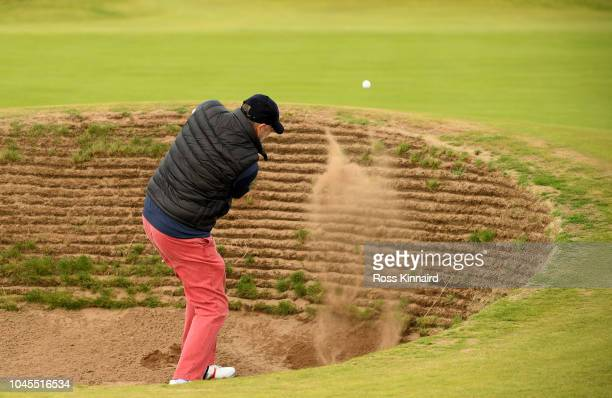 Graham Head plays out of a bunker during day one of the 2018 Alfred Dunhill Links Championship at Carnoustie on October 4, 2018 in St Andrews,...