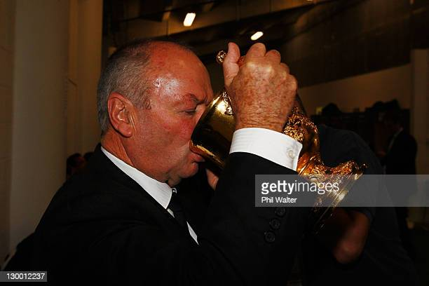 Graham Henry coach of the All Blacks drinks from the Webb Ellis Cup after the 2011 IRB Rugby World Cup Final match between France and New Zealand at...