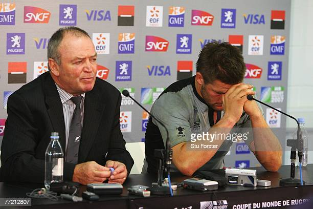 Graham Henry head coach of New Zealand and a dejected Richie McCaw of New Zealand attend the postmatch press conference during the Quarter Final of...
