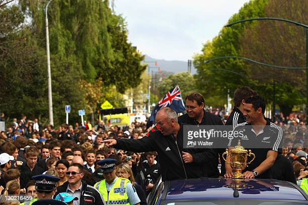 Graham Henry Steve Hansen Richie McCaw and Dan Carter of the All Blacks wave to the crowd with the Webb Ellis Cup during the New Zealand All Blacks...