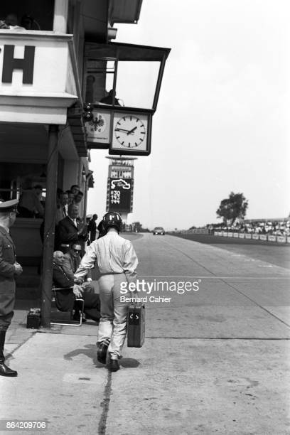Graham Hill, 1000 Km of Nürburgring, Nurburgring, 31 May 1964. Graham Hill carrying a jerrican of petrol to his Ferrari 275P.