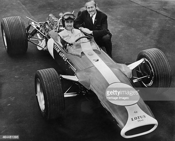 Graham Hill and Colin Chapman with Lotus 49, 1967. Hill made his debut at Monaco in 1958 and went on to win 14 Grands Prix. He also won the Formula...