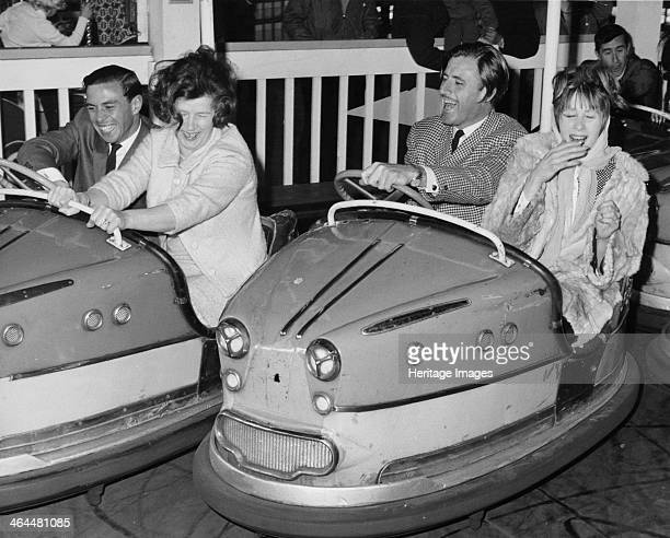 Graham Hill and Jim Clark on Dodgem cars at Butlins Bognor Regis 1960s Mrs CampbellJones is on the Dodgem with Hill and Mrs Gregor Grant is in the...