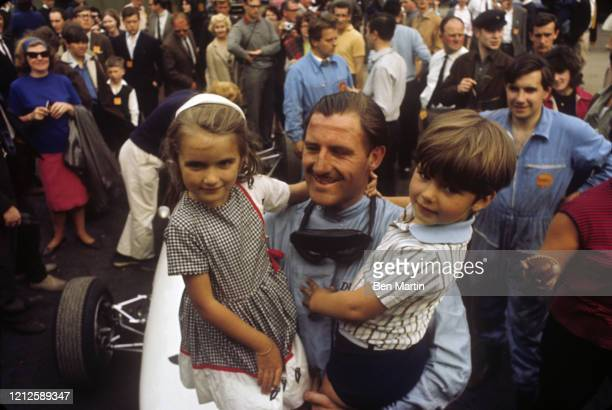 Graham Hill British racing driver and team owner, after winning the 1965 Monaco Grand Prix with his children Brigitte and Damon, May 30, 1965.