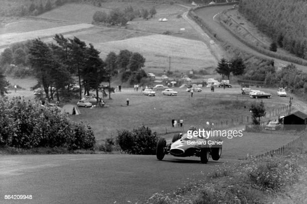 Graham Hill, BRM P57, Grand Prix of Germany, Nurburgring, 04 August 1963. Graham Hill's BRM is airborne on the Nürburgring roller coaster.