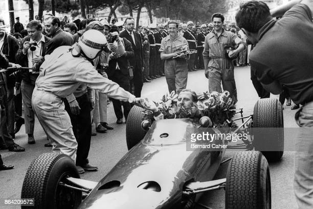 Graham Hill, Jackie Stewart, BRM P261, Grand Prix of Monaco, Circuit de Monaco, 30 May 1965. Jackie Stewart congratulates Graham Hill on his third...