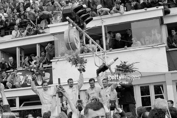 Graham Hill Jo Bonnier Jean Guichet Nino Vaccarella 24 Hours of Le Mans Le Mans 22 June 1964 Graham Hill and Jo Bonnier with Le Mans 1964 winners...