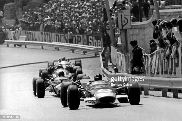 Graham Hill Jo Siffert John Surtees Jochen Rindt LotusFord 49B Grand Prix of Monaco Circuit de Monaco 26 May 1968 Graham Hill leads at the wheel of...
