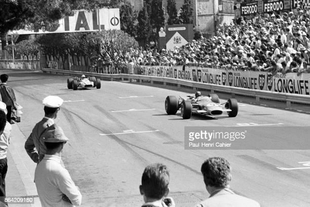 Graham Hill John Surtees LotusFord 49B Honda RA301 Grand Prix of Monaco Circuit de Monaco 26 May 1968 Graham Hil's LotusFord 49 ahead of John...