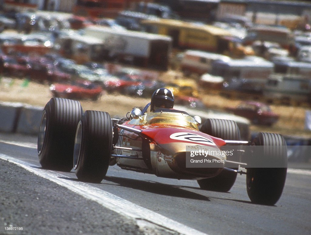 Graham Hill of Great Britain drives the #10 Gold Leaf Team Lotus Lotus 49 Ford V8 during the Spanish Grand Prix on 12th May 1968 at the Jarama Circuit, Madrid, Spain