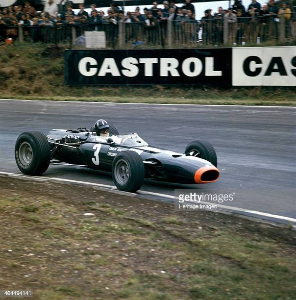 Graham Hill racing a BRM P261 British Grand Prix Brands Hatch Kent 1966 Hill eventually finished third in this race Hill was one of the first Formula...