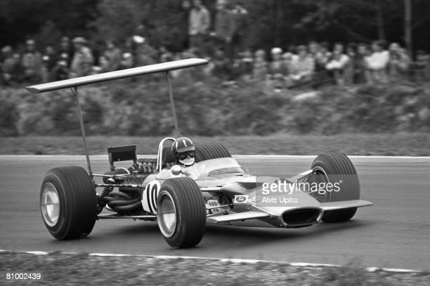 Graham Hill racing the Lotus-Ford Type 49B at the United States Grand Prix held at Watkins Glen, New York on October 6, 1968.