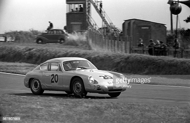 Graham HillDan Gurney's PorscheAbarth 356B Carrera GTL after St Mary's in the Tourist Trophy Goodwood England 19 Aug 1961