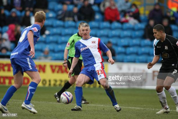 Graham Kavanagh of Carlisle United plays the ball during the Coca Cola League One Match between Carlisle United and Northampton Town at Brunton Park...
