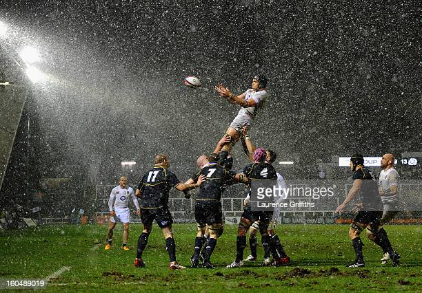 Graham Kitchener of England rises in the snow to win the lineout during the International Friendly match between England Saxons and Scotland A at...