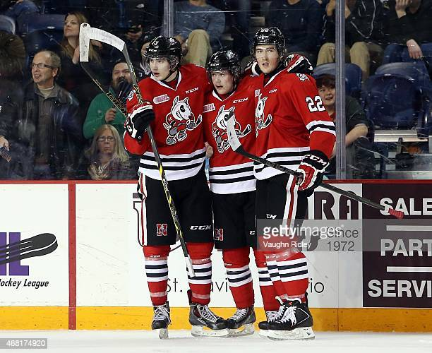Graham Knott Mikkel Aagaard and Ryan Mantha of the Niagara IceDogs celebrate a goal during Game 3 of the Eastern Conference QuarterFinals against the...