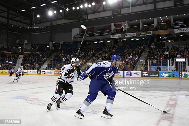 Graham Knott of the Niagara Ice Dogs chases Matt Schmalz of the Sudbury Wolves during an OHL game between the Sudbury Wolves and the Niagara Ice Dogs...