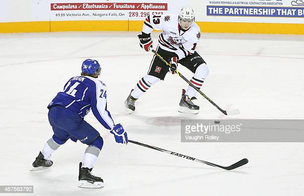 Graham Knott of the Niagara Ice Dogs trys to get past Evan de Haan of the Sudbury Wolves during an OHL game between the Sudbury Wolves and the...