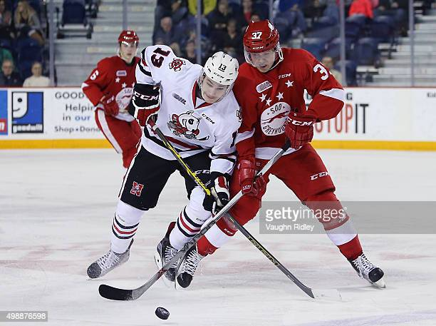 Graham Knott of the Niagara IceDogs battles for the puck with Gustav Bouramman of the Sault Ste Marie Greyhounds during an OHL game at the Meridian...