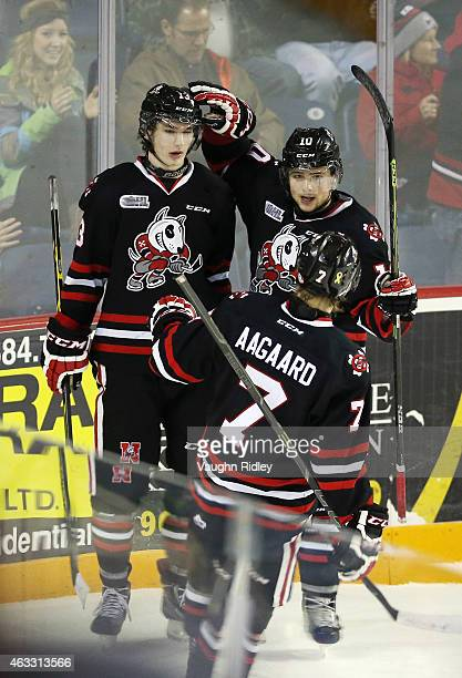 Graham Knott of the Niagara IceDogs celebrates a goal with Anthony Di Fruscia and Mikkel Aagaard during an OHL game against the Mississauga...