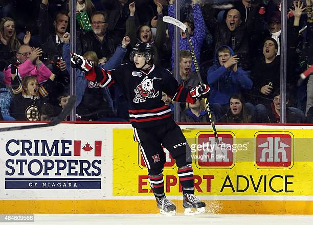 Graham Knott of the Niagara IceDogs celebrates his second goal during an OHL game against the North Bay Battalion at the Meridian Centre on February...
