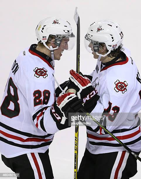 Graham Knott of the Niagara IceDogs congratulates Aaron Haydon after he scored a late goal during an OHL game between the Oshawa Generals and the...