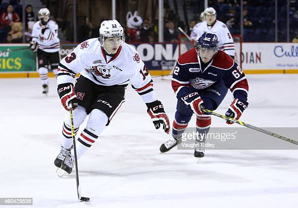 Graham Knott of the Niagara IceDogs gets past Tye Felhaber of the Saginaw Spirit during an OHL game between the Saginaw Spirit and the Niagara...