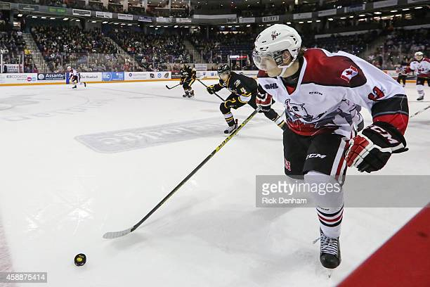 Graham Knott of the Niagara IceDogs outskates Jeff King of the Sarnia Sting during a game at the Meridian Center on November 8 2014 in St Catharines...