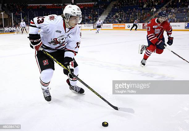 Graham Knott of the Niagara IceDogs skates with the puck during an OHL game between the Oshawa Generals and the Niagara IceDogs at the Meridian...