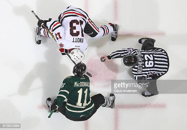 Graham Knott of the Niagara IceDogs takes a faceoff against Owen MacDonald of the London Knights during an OHL game at Budweiser Gardens on February...