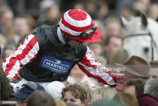 Graham Lee on Amberleigh house is congratulated by trainer Ginger McCain after Red Rum's trainer tasted Aintree success againat the 2004 Martell...
