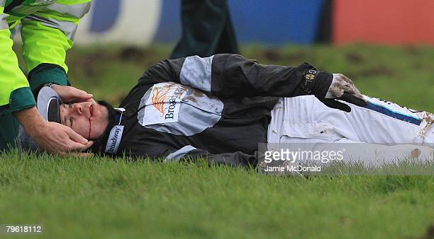 Graham Lee receives medical attention after taking a fall during the BetFredPoker Novices' Handicap Steeple Chase at Huntingdon Race Course on...