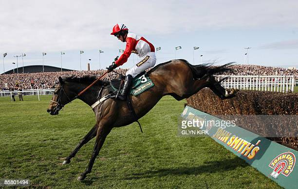 Graham Lee rides French horse KALAHARI KING over the last fence to win The John Smith's Maghull Novices' Steeple Chase on the third day of the Grand...