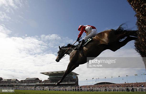 Graham Lee rides KALAHARI KING over a fence during the Grand National at Aintree Racecourse in Liverpool northwest England on April 4 2009 Rank...