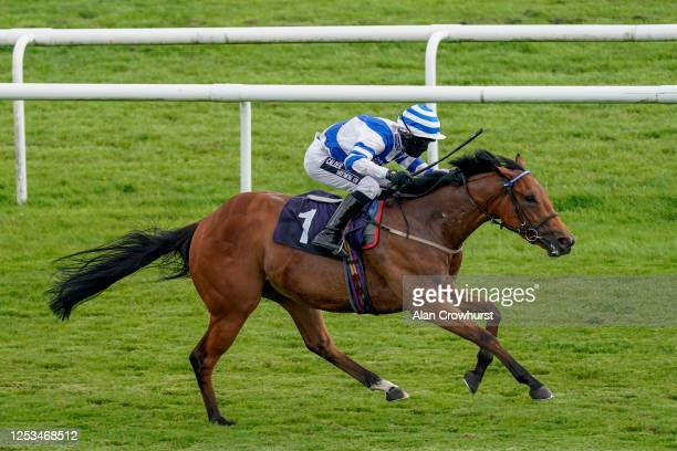 Graham Lee riding Redzone win The Sky Sports Racing Sky 415 Handicap at Doncaster Racecourse on June 30, 2020 in Doncaster, England. Horseracing...
