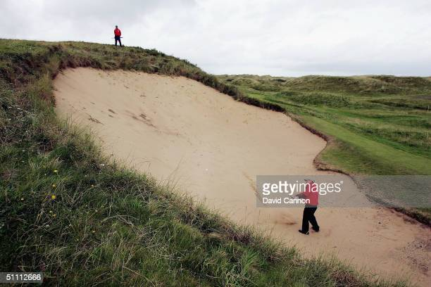 Graham Marsh of Australia plays his second shot from the huge bunker 'Bg Bertha' on the 17th hole during the third round of the Senior British Open...