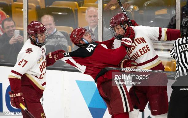 Graham McPhee of the Boston College Eagles grabs the jersey of Casey Dornbach of the Harvard Crimson as he was a choke hold on Patrick Giles of the...