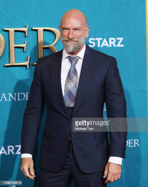 "Graham McTavish attends the Los Angeles Premiere of Starz's ""Outlander"" Season 5 held at Hollywood Palladium on February 13, 2020 in Los Angeles,..."