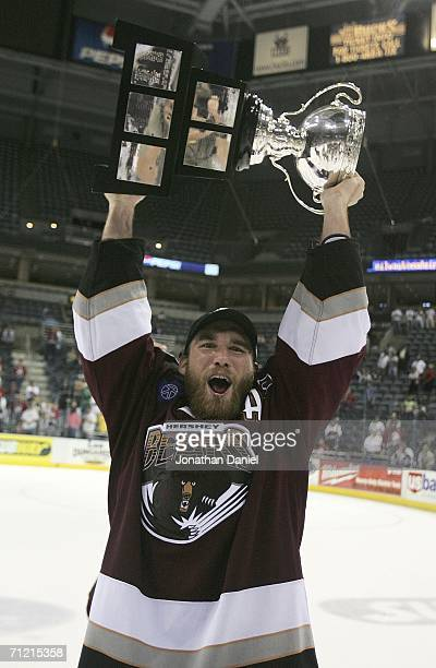 Graham Mink of the Hershey Bears celebrates with the Calder Cup after the Bears defeated the Milwaukee Admirals in game six of the AHL Calder Cup...