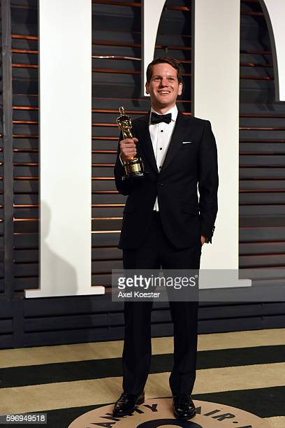 Graham Moore winner of the Best Screenplay award attends the 2015 Vanity Fair Oscar Party hosted by Graydon Carter at the Wallis Annenberg Center for...