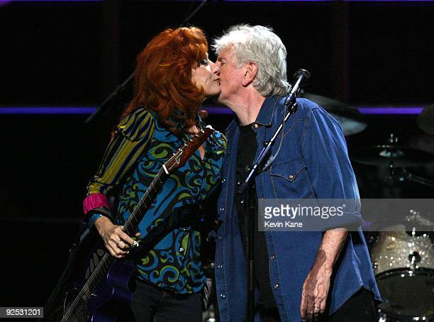 Graham Nash of Crosby Stills and Nash with Bonnie Raitt onstage at the 25th Anniversary Rock Roll Hall of Fame Concert at Madison Square Garden on...