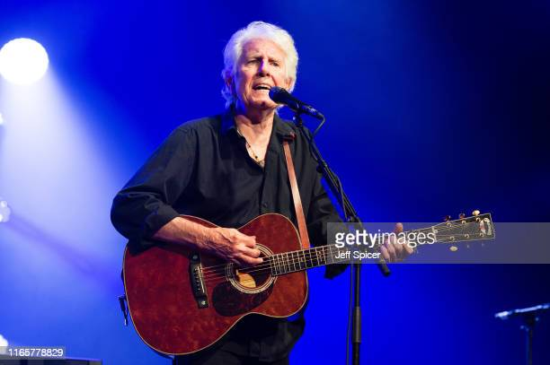 Graham Nash performs on stage during the Cambridge Folk Festival 2019 at Cherry Hinton Hall on August 02 2019 in Cambridge England
