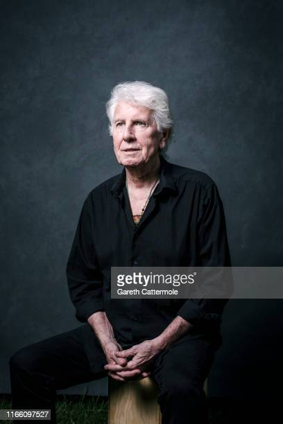 Graham Nash poses during a portrait session at the Cambridge Folk Festival 2019 at Cherry Hinton Hall on August 02 2019 in Cambridge England