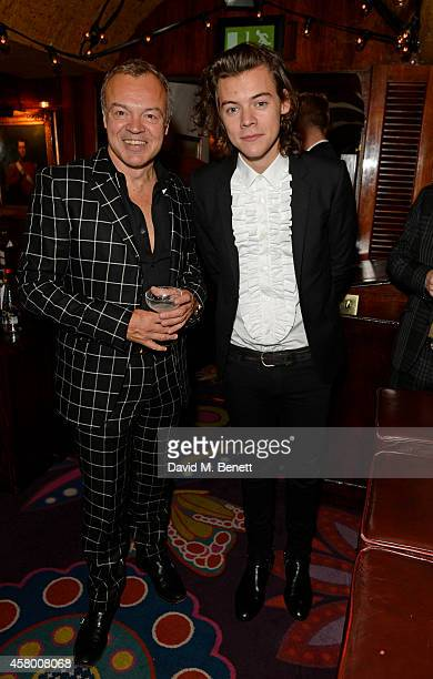 Graham Norton and Harry Styles attend the launch of Annabel's DocuFilm 'A String of Naked Lightbulbs' at Annabel's on October 28 2014 in London...