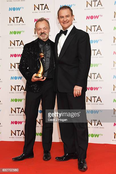 Graham Norton and Hugh Bonneville pose in the winners room at the National Television Awards at The O2 Arena on January 25 2017 in London England