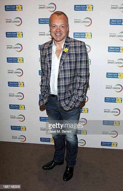 Graham Norton attends the launch of Samsung's NX Smart Camera at a charity auction with David Bailey in aid of Marie Curie Cancer Care at the Bulgari...