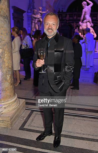 Graham Norton attends the Samsung BlueHouse private view of the 'Alexander McQueen Savage Beauty' exhibition at the Victoria Albert Museum on March...